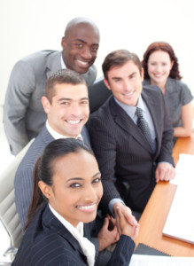 Smiling business team in a meeting shaking hands
